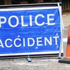 A police warning sign at the scene of the accident