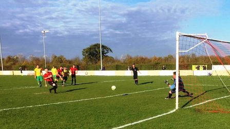 Corey Kingston scoring a penalty for Huntingdon Town in their win against Holwell Sports on Saturday