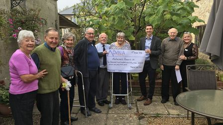 Maycroft care home residents handing over a cheque for £2263.43 to Dr Steve Andrews from Alzheimer'