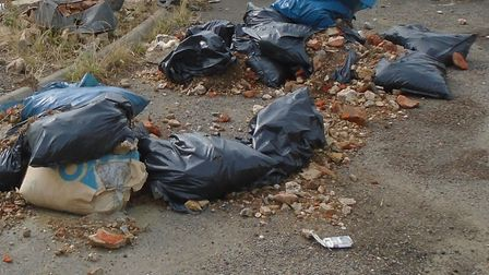 The fly-tipped waste near the M1 bridge at Hogg End Lane in St Albans district.