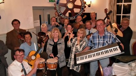 members of St Ives Rotary Club with many of the instruments donated. Picture: CONTRIBUTED