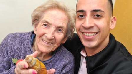 Care UK resident Zena Barcley with team member Sam Shepard enjoying the visit from ZooLab. Photo: L