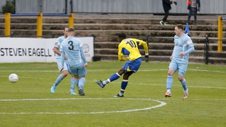David Moyo stirkes the ball into the back of the net to secure all three points for the Saints. Pict