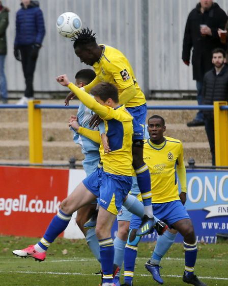 David Moyo wins a header. Picture: LEIGH PAGE
