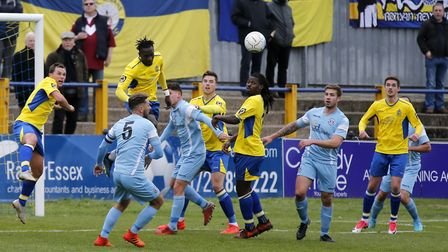 David Moyo heads clear from a Slough Town set piece. Picture: LEIGH PAGE