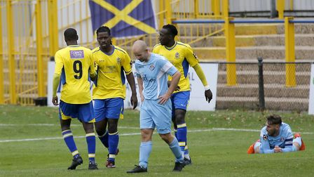 Saints congratulate Clovis Kamdjo on his equaliser late in the first half. Picture: LEIGH PAGE