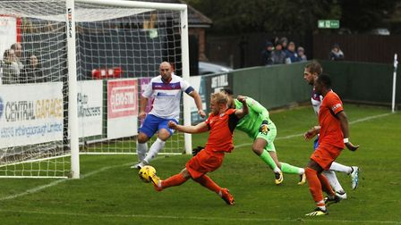 Ollie Snaith pounces for St Ives Town's goal in their FA Trophy exit at AFC Rushden & Diamonds. Pict