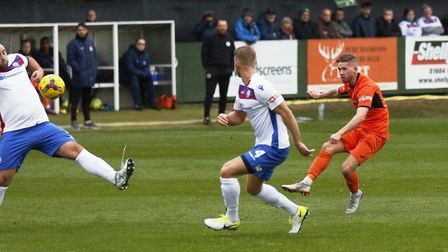 George Bailey gets in a shot during St Ives Town's defeat at AFC Rushden & Diamonds in the FA Trophy
