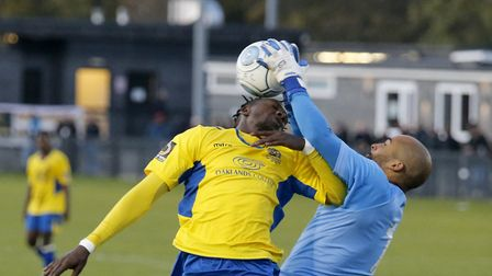 David Moyo has the ball taken off his head. Picture: LEIGH PAGE