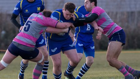 Bradley Robinson drives forward for St Ives against Olney. Picture: PAUL COX