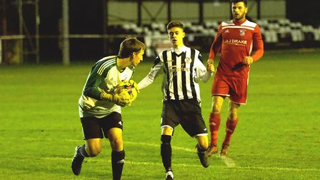 Godmanchester Rovers' goalkeeping physio Sam Palmer in action at St Ives Town. Picture: LOUISE THOMP