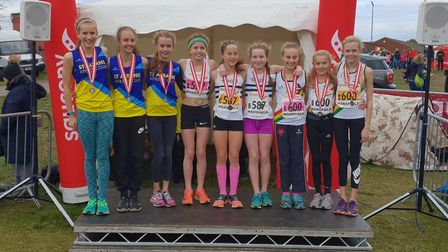 Phoebe Gill, Hannah Read and Florence Crowley of St Albans Athletics Club won the silver medal at th