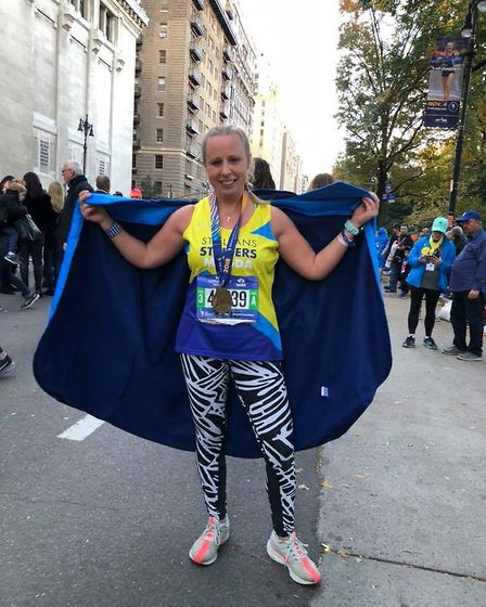 St Albans Striders' Magdalena Petrus celebrates at the end of the New York Marathon.