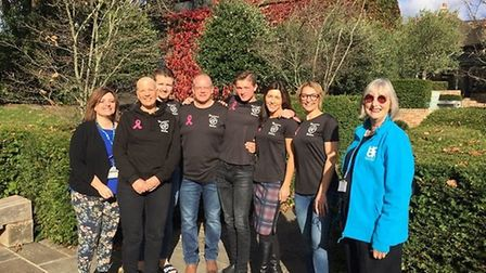 Running group hand over cash to cancer charity