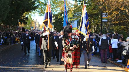 Piper, Roy Slone, leads the parade away from the Royston War Memorial after Remembrance Sunday Servi