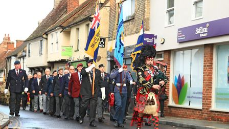 The Remembrance Parade moves along Kneesworth St. before Remembrance Sunday Service in Royston Town.