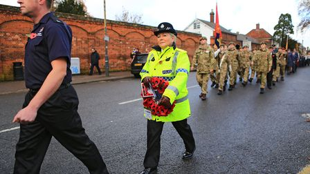Police join in the wreath lying before Remembrance Sunday Service in Royston Town. Picture: KEVIN RI