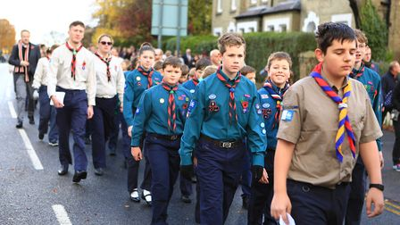 Local Scout Group march in the parade before the Remembrance Sunday Service in Royston Town. Picture