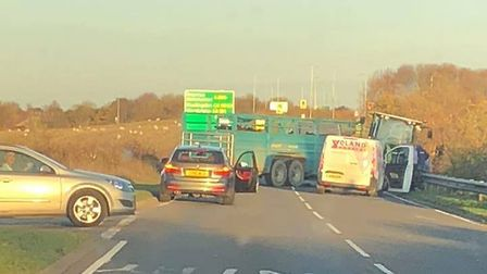 Police are currently attending to an overturned tractor on the A505, which was carrying a trailer co