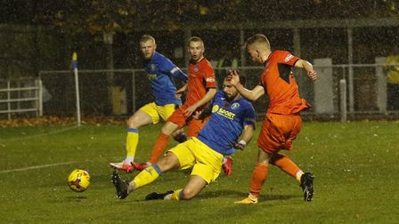 St Ives Town man George Bailey is denied an equaliser during the defeat at King's Lynn Town. Picture