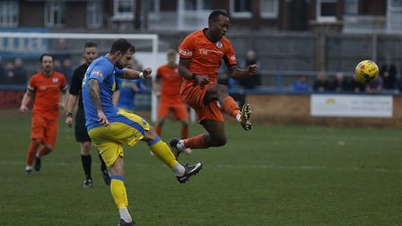 Munashe Sundire in mid-air for St Ives Town as they lost at King's Lynn Town. Picture: LOUISE THOMPS