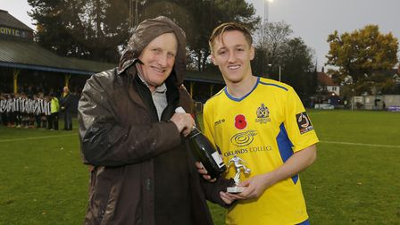 Ben Wyatt received the October player of the month award prior to the Chippenham game from Jim Pratt
