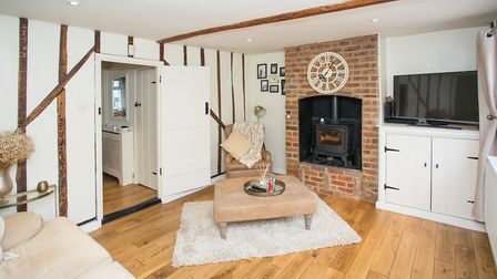 The living room has a feature brick fireplace and wood burning stove. Picture: Frost's
