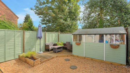 There is a well maintained rear garden with side access to a private car park . Picture: Frost's