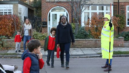 Bernards Heath school pupils and parents cross the road with the help of the new patrolled crossing.
