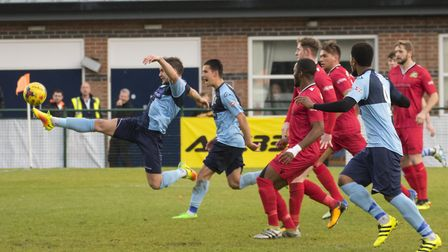 St Neots Town defender Russell Short is at full-stretch to get an effort on goal during their FA Tro