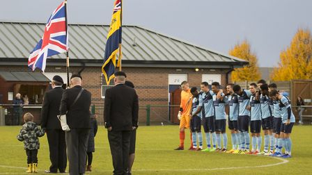 St Neots Town players pay their respects during a minute's silence ahead of their FA Trophy clash ag