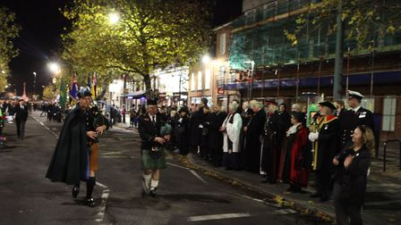 Two pipers lead the Salute of the Parade during the St Albans Remembrance Day Parade 2018. {Craig Sh