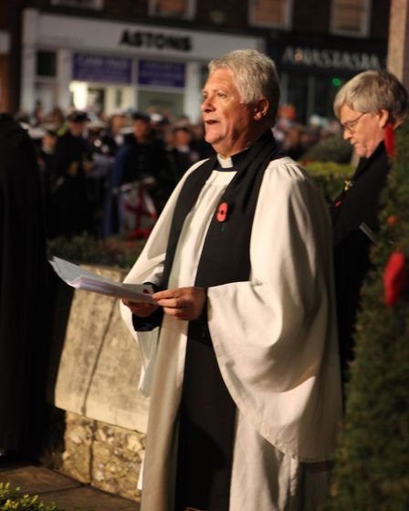 The Revd Mark Dearnley, Vicar of St Peters Church addresses the crowd at the St Albans Remembrance D