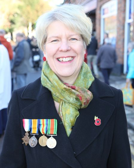 Janice Norwood wears her grandfather William Lacock's medals at the St Albans Remembrance Day Parade
