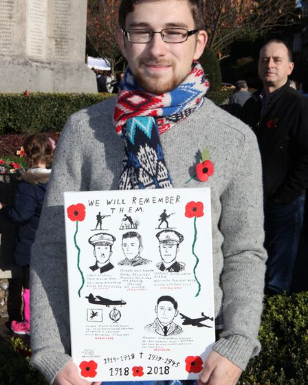 Chris Richards, a University first year student, displays a painting that he made of his family mem