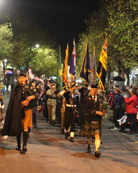 The St Albans Remembrance Day Parade 2018 flag bearers march along St Peters Street. {Craig Shephear