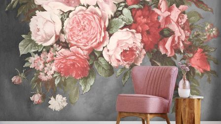 This still life wallpaper mural features pink and red hand-painted vintage flowers on a painterly gr