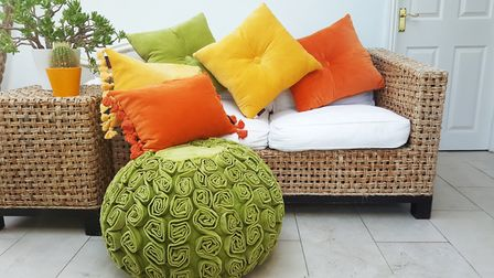 Cushions are a simple way to add a dash of colour, like these from Fiona and Terry; 33 (square) and