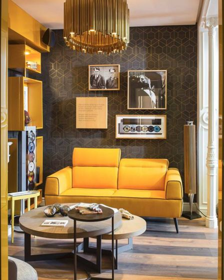 The centre point to this yellow design is a mid-century modern chandelier inspired by the jazz music