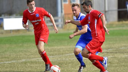 Buster Harradine (centre) scored both Godmanchester Rovers goals in their win at Stowmarket. Picture