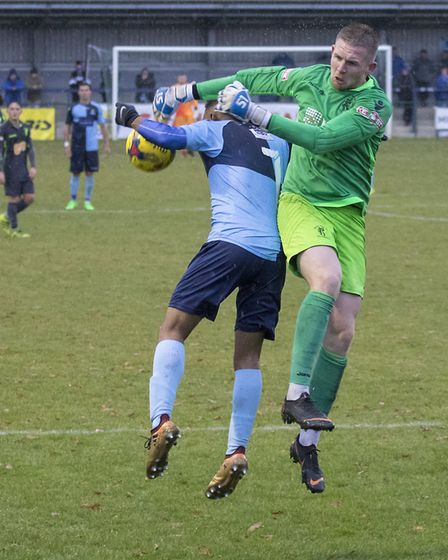St Neots Town man Dion Sembie-Ferris does battle with the Matlock Town goalkeeper. Picture: CLAIRE H