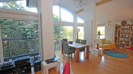 The spacious open plan sitting/day/dining room has solid bamboo flooring. Picture: Ashtons