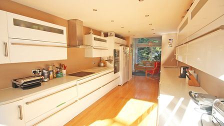 The kitchen leads out to the terrace. Picture: Ashtons