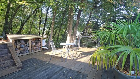 The side decking area is just one part of the garden, which is also home to a bluebell wood and a Ja