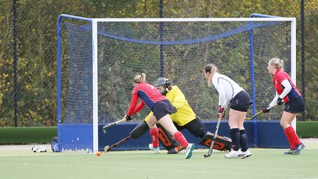 Steph Oliver tries to finish off a short corner in the match between Harpenden and Stevenage ladies