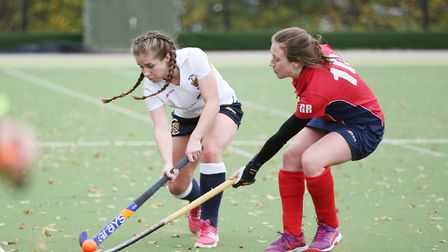 Beth Carlisle takes on Gemma Roakey in the match between Harpenden and Stevenage ladies first teams.