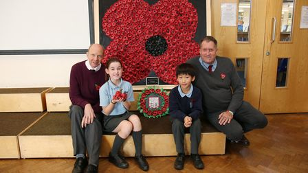 Skyswood School head Bob Bridle and site manager Dave Collenette with year five pupils Becky and Dan