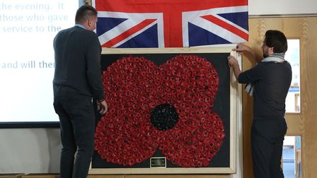 Skyswood School site manager Dave Collenette and year five teacher David Oswin unveil the poppy disp