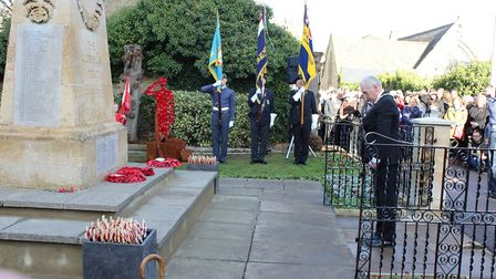Cllr Barry Chapman at wreath laying in cemetery