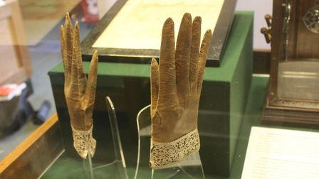 A pair of lamb's skin gloves loaned to the museum.